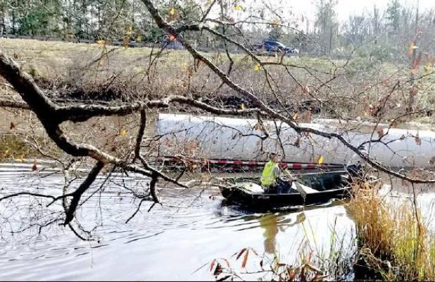 Tractor trailer crashes through guardrail into pond