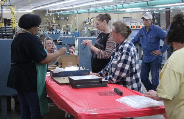 Employees at Stanco Safety Products Assembling Face Shields